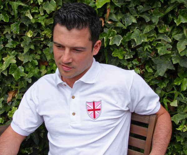 White polo shirt with shield badge