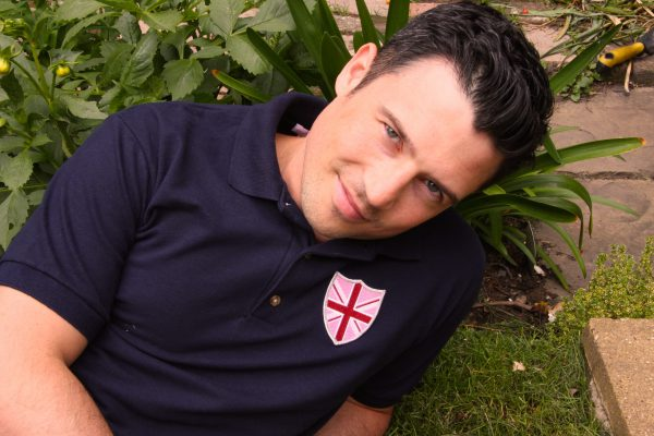 Navy polo shirt with shield badge